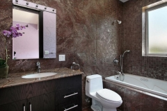 Powder room with granite walls